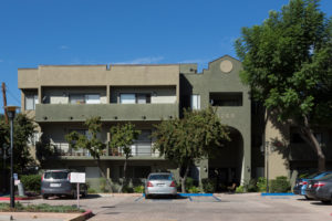 Exterior with balconies, parking lot, 1255 on building