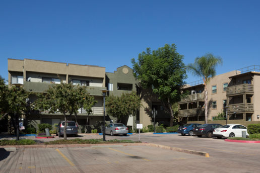 Exterior with balconies, parking lot